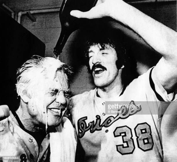 John Lowenstein of the Baltimore Orioles pours champagne over manager Earl Weaver's head after the Orioles defeated the California Angels in Game 4...