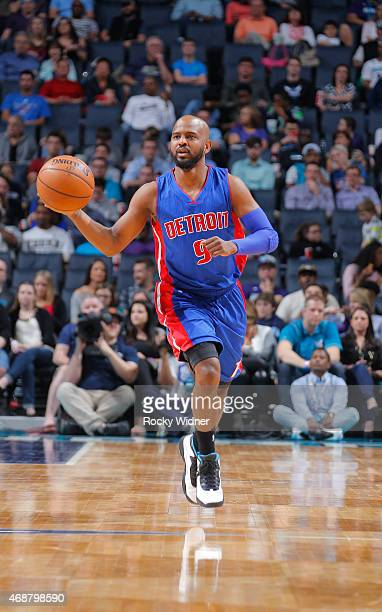 John Lucas III of the Detroit Pistons brings the ball up the court against the Charlotte Hornets on April 1 2015 at Time Warner Cable Arena in...