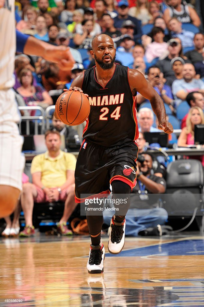 <a gi-track='captionPersonalityLinkClicked' href=/galleries/search?phrase=John+Lucas+III&family=editorial&specificpeople=784337 ng-click='$event.stopPropagation()'>John Lucas III</a> #24 of the Miami Heat drives to the basket against the Orlando Magic during a preseason game on October 13, 2015 at Amway Center in Orlando, Florida.