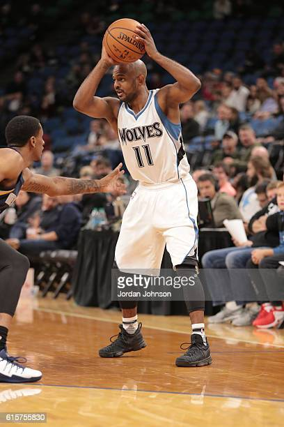 John Lucas III of the Minnesota Timberwolves handles the ball during a preseason game against the Memphis Grizzlies on October 19 2016 at Target...