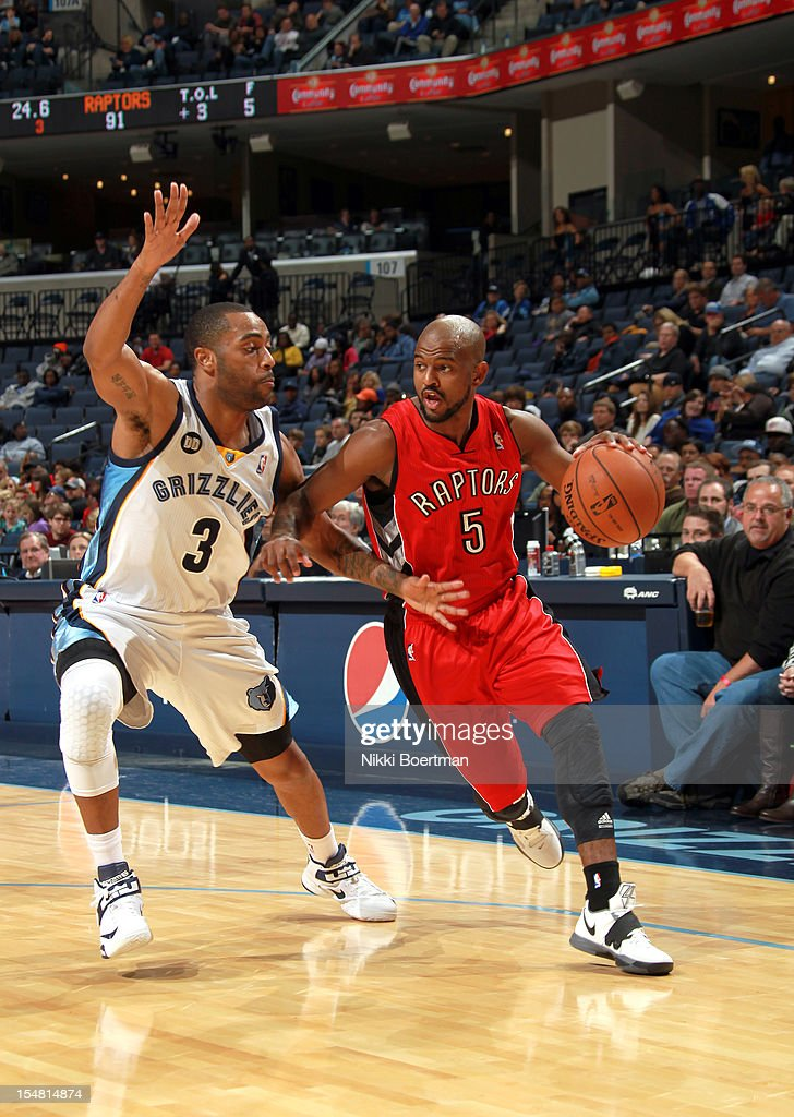 John Lucas III #5 of the Toronto Raptors drives around <a gi-track='captionPersonalityLinkClicked' href=/galleries/search?phrase=Wayne+Ellington&family=editorial&specificpeople=2351537 ng-click='$event.stopPropagation()'>Wayne Ellington</a> #3 of the Memphis Grizzlies on October 26, 2012 at FedExForum in Memphis, Tennessee.