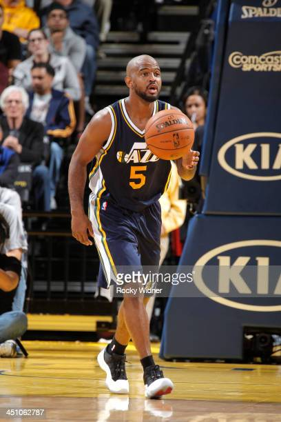 John Lucas III of the Utah Jazz brings the ball up the court against the Golden State Warriors on November 16 2013 at Oracle Arena in Oakland...