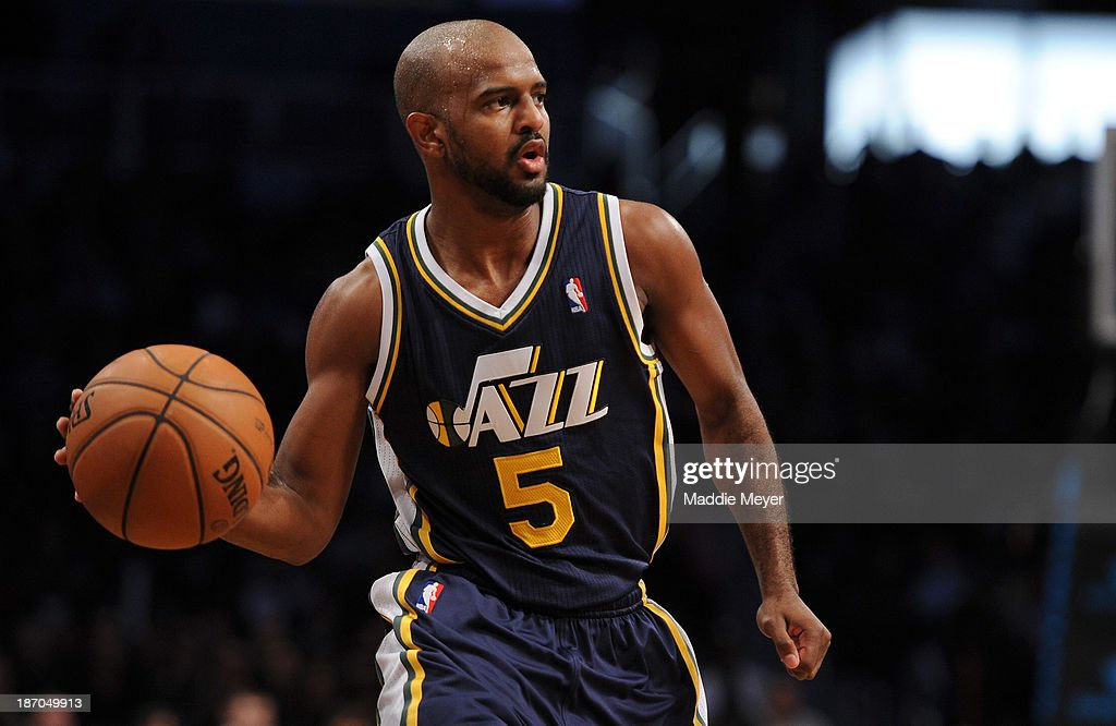 <a gi-track='captionPersonalityLinkClicked' href=/galleries/search?phrase=John+Lucas+III&family=editorial&specificpeople=784337 ng-click='$event.stopPropagation()'>John Lucas III</a> #5 of the Utah Jazz carries the ball down court against the Brooklyn Nets during the second half at Barclays Center on November 5, 2013 in the Brooklyn borough of New York City. The Nets defeat the Jazz 104-88.