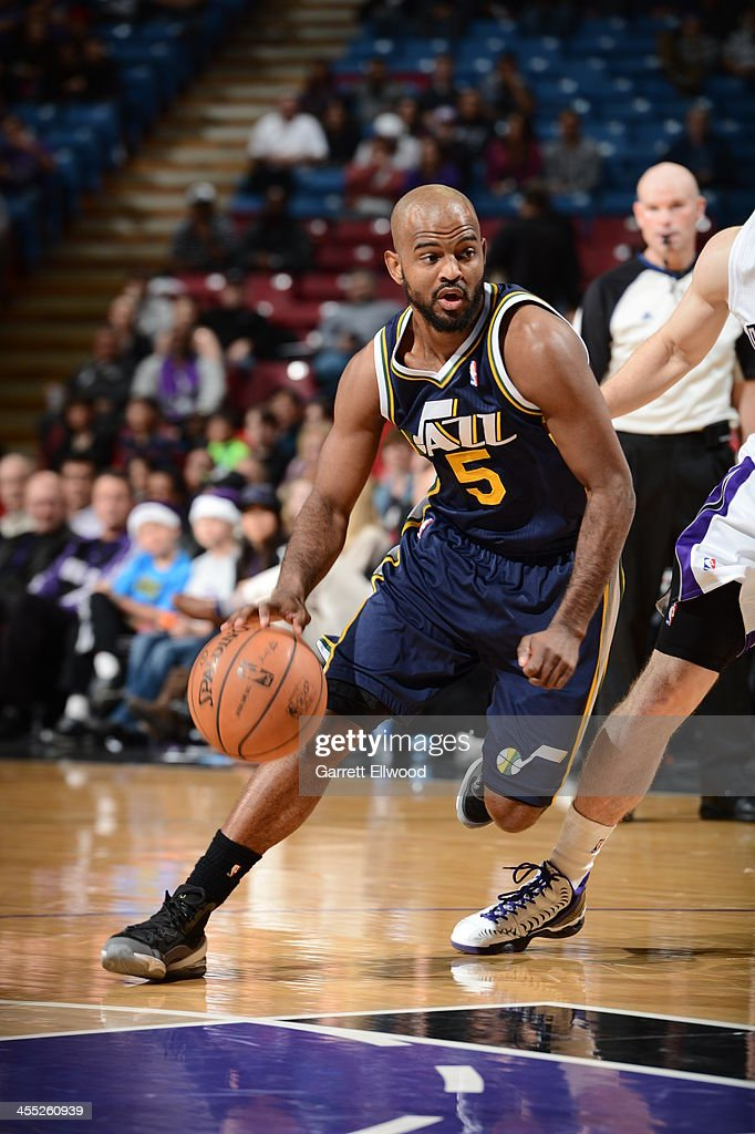 <a gi-track='captionPersonalityLinkClicked' href=/galleries/search?phrase=John+Lucas+III&family=editorial&specificpeople=784337 ng-click='$event.stopPropagation()'>John Lucas III</a> #5 of the Utah Jazz drives to the basket against the Sacramento Kings at Sleep Train Arena on December 11, 2013 in Sacramento, California.