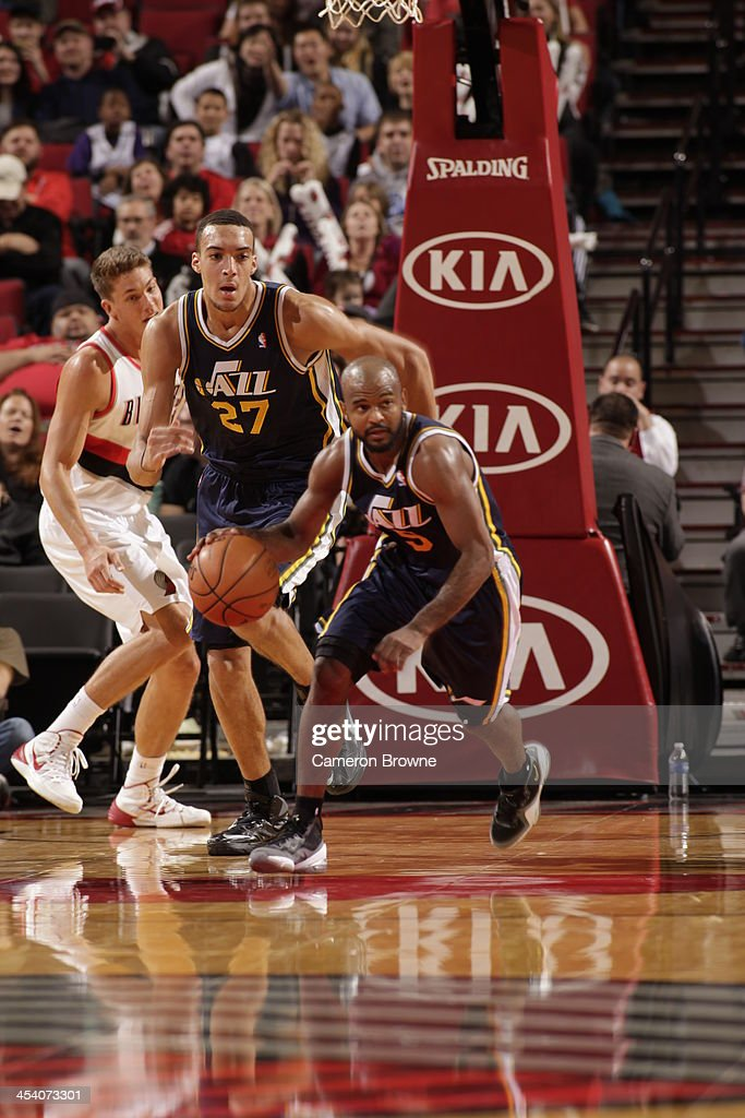 <a gi-track='captionPersonalityLinkClicked' href=/galleries/search?phrase=John+Lucas+III&family=editorial&specificpeople=784337 ng-click='$event.stopPropagation()'>John Lucas III</a> #5 of the Utah Jazz drives up-court against the Portland Trail Blazers on December 6, 2013 at the Moda Center Arena in Portland, Oregon.