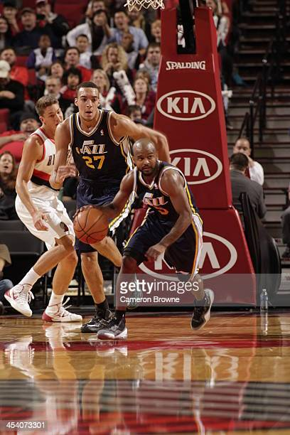 John Lucas III of the Utah Jazz drives upcourt against the Portland Trail Blazers on December 6 2013 at the Moda Center Arena in Portland Oregon NOTE...