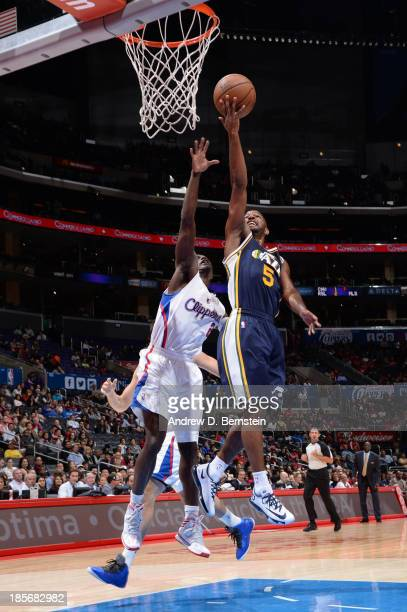 John Lucas III of the Utah Jazz goes up for a shot against the Los Angeles Clippers at Staples Center on October 23 2013 in Los Angeles California...