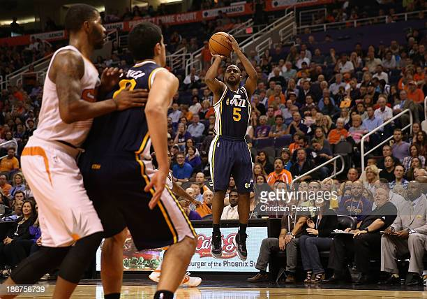 John Lucas III of the Utah Jazz puts up a shot during the NBA game against the Phoenix Suns at US Airways Center on November 1 2013 in Phoenix...