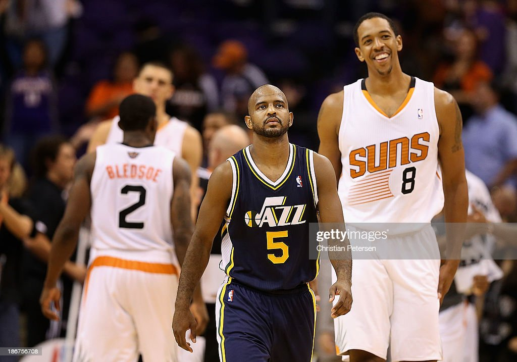 <a gi-track='captionPersonalityLinkClicked' href=/galleries/search?phrase=John+Lucas+III&family=editorial&specificpeople=784337 ng-click='$event.stopPropagation()'>John Lucas III</a> #5 of the Utah Jazz reacts as he walks off the court past <a gi-track='captionPersonalityLinkClicked' href=/galleries/search?phrase=Channing+Frye&family=editorial&specificpeople=206815 ng-click='$event.stopPropagation()'>Channing Frye</a> #8 of the Phoenix Suns following the NBA game at US Airways Center on November 1, 2013 in Phoenix, Arizona. The Suns defeated the Jazz 87-84.