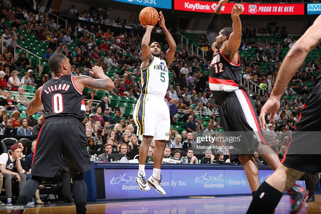 <a gi-track='captionPersonalityLinkClicked' href=/galleries/search?phrase=John+Lucas+III&family=editorial&specificpeople=784337 ng-click='$event.stopPropagation()'>John Lucas III</a> #5 of the Utah Jazz shoots against <a gi-track='captionPersonalityLinkClicked' href=/galleries/search?phrase=Damian+Lillard&family=editorial&specificpeople=6598327 ng-click='$event.stopPropagation()'>Damian Lillard</a> #0 and <a gi-track='captionPersonalityLinkClicked' href=/galleries/search?phrase=LaMarcus+Aldridge&family=editorial&specificpeople=453277 ng-click='$event.stopPropagation()'>LaMarcus Aldridge</a> #12 of the Portland Trail Blazers at Energy Solutions Arena on October 16, 2013 in Salt Lake City, Utah.