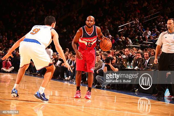 John Lucas III of the Washington Wizards handles the ball against the New York Knicks during a game at Madison Square Garden in New York City on...