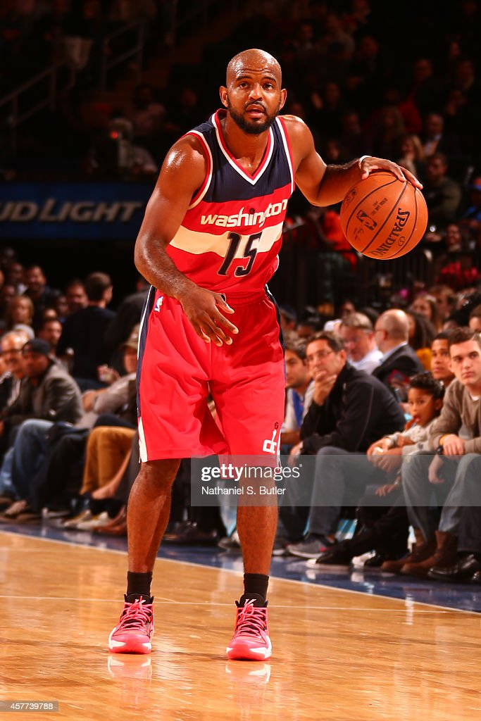 <a gi-track='captionPersonalityLinkClicked' href=/galleries/search?phrase=John+Lucas+III&family=editorial&specificpeople=784337 ng-click='$event.stopPropagation()'>John Lucas III</a> #15 of the Washington Wizards handles the ball against the New York Knicks during a game at Madison Square Garden in New York City on October 22, 2014.
