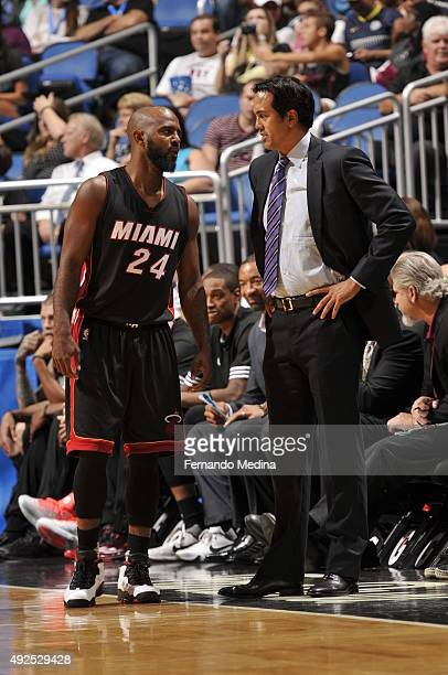 John Lucas III speaks with head coach Erik Spoelstra of the Miami Heat during a preseason game on October 13 2015 at Amway Center in Orlando Florida...