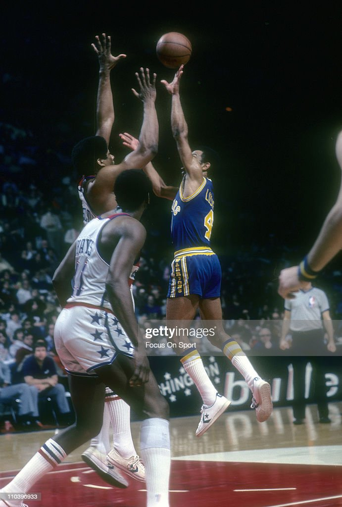 John Lucas #4 of the Golden State Warriors goes up to shoot over <a gi-track='captionPersonalityLinkClicked' href=/galleries/search?phrase=Wes+Unseld&family=editorial&specificpeople=212864 ng-click='$event.stopPropagation()'>Wes Unseld</a> #41 of the Washington Bullets during an NBA basketball game circa 1980 at the Baltimore Civic Center in Baltimore, Maryland. Lucas played for the Warriors from 1978-81.