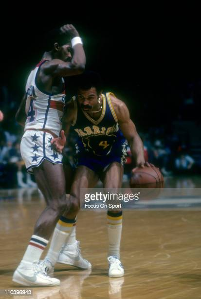John Lucas of the Golden State Warriors is guarded closely by Tom Henderson of the Washington Bullets during an NBA basketball game circa 1979 at the...