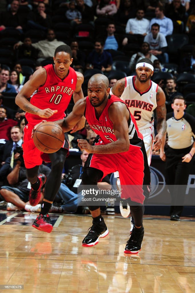 John Lucas #5 of the Toronto Raptors brings the ball up court against the Atlanta Hawks on January 30, 2013 at Philips Arena in Atlanta, Georgia.