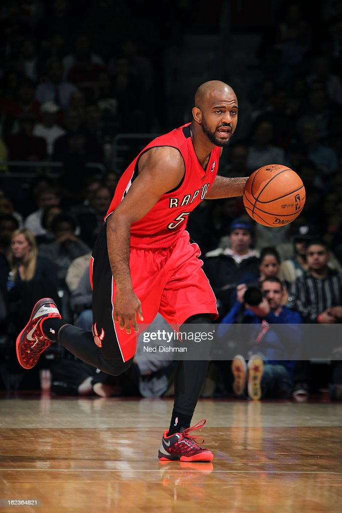 John Lucas #5 of the Toronto Raptors brings the ball up court against the Washington Wizards at the Verizon Center on February 19, 2013 in Washington, DC.
