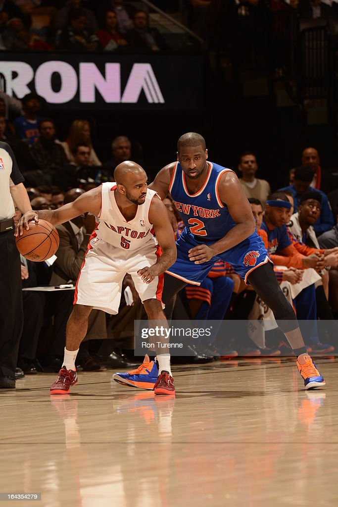 John Lucas #5 of the Toronto Raptors controls the ball against Raymond Felton #2 of the New York Knicks on March 22, 2013 at the Air Canada Centre in Toronto, Ontario, Canada.