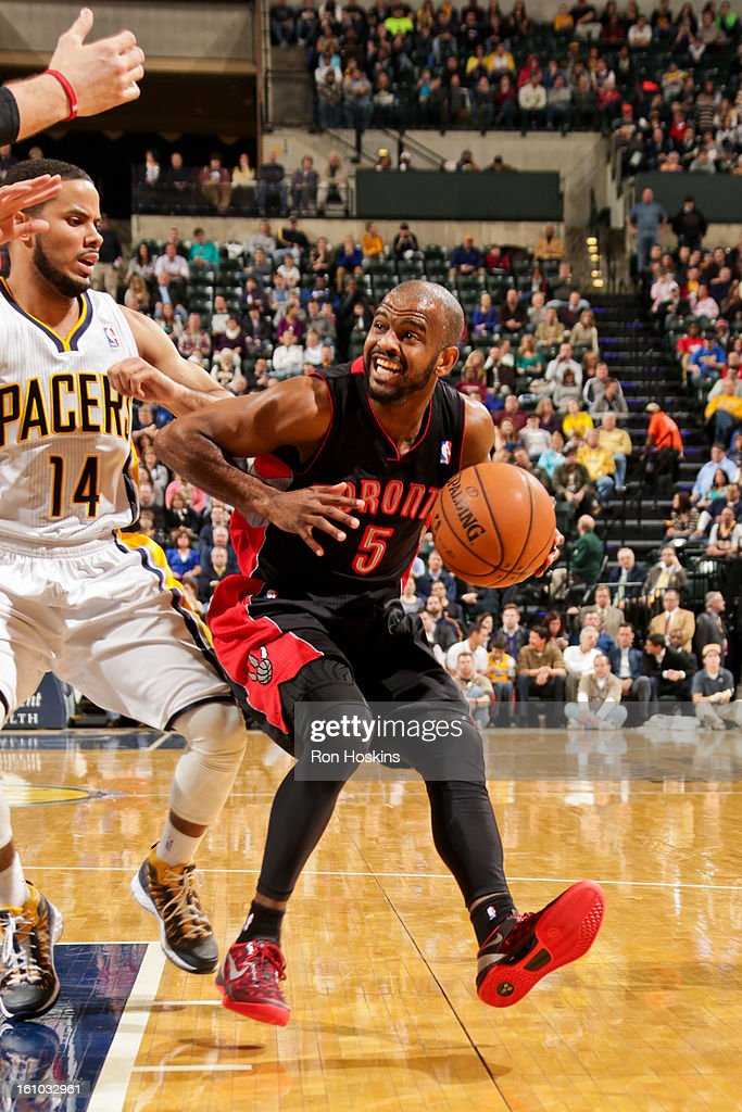 John Lucas #5 of the Toronto Raptors drives against D.J. Augustin #14 of the Indiana Pacers on February 8, 2013 at Bankers Life Fieldhouse in Indianapolis, Indiana.