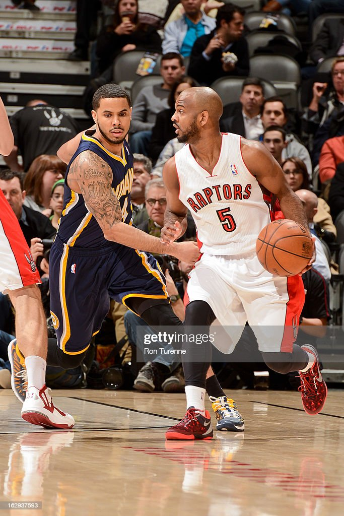 John Lucas #5 of the Toronto Raptors drives against D.J. Augustin #14 of the Indiana Pacers on March 1, 2013 at the Air Canada Centre in Toronto, Ontario, Canada.
