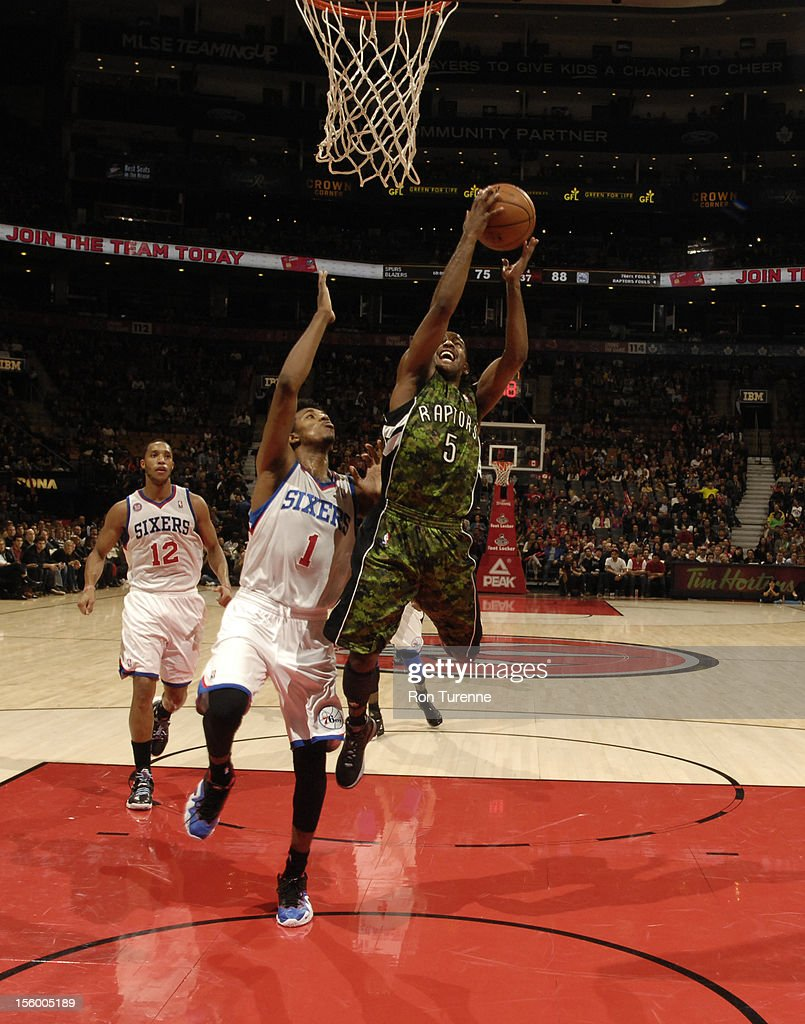 John Lucas #5 of the Toronto Raptors drives to the basket against Nick Young #1 of the Philadelphia 76ers during the game on November 10, 2012 at the Air Canada Centre in Toronto, Ontario, Canada.