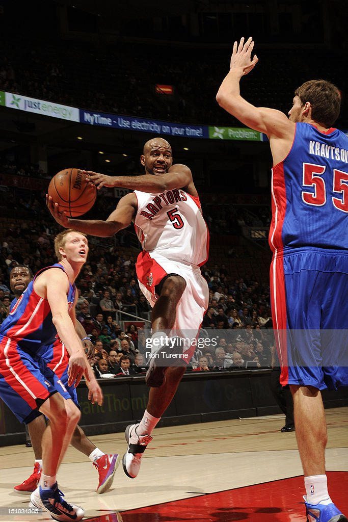 John Lucas #5 of the Toronto Raptors drives to the basket against Vyacheslav Kravstov #55 of the Detroit Pistons on October 12, 2012 at the Air Canada Centre in Toronto, Ontario, Canada.