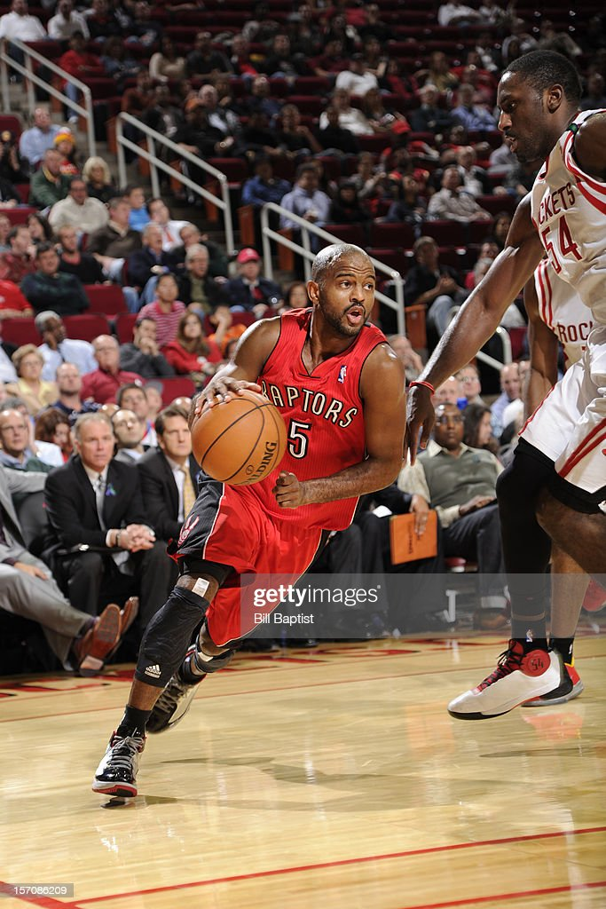 John Lucas #5 of the Toronto Raptors drives to the basket against <a gi-track='captionPersonalityLinkClicked' href=/galleries/search?phrase=Patrick+Patterson&family=editorial&specificpeople=2928099 ng-click='$event.stopPropagation()'>Patrick Patterson</a> #54 of the Houston Rockets on November 27, 2012 at the Toyota Center in Houston, Texas.