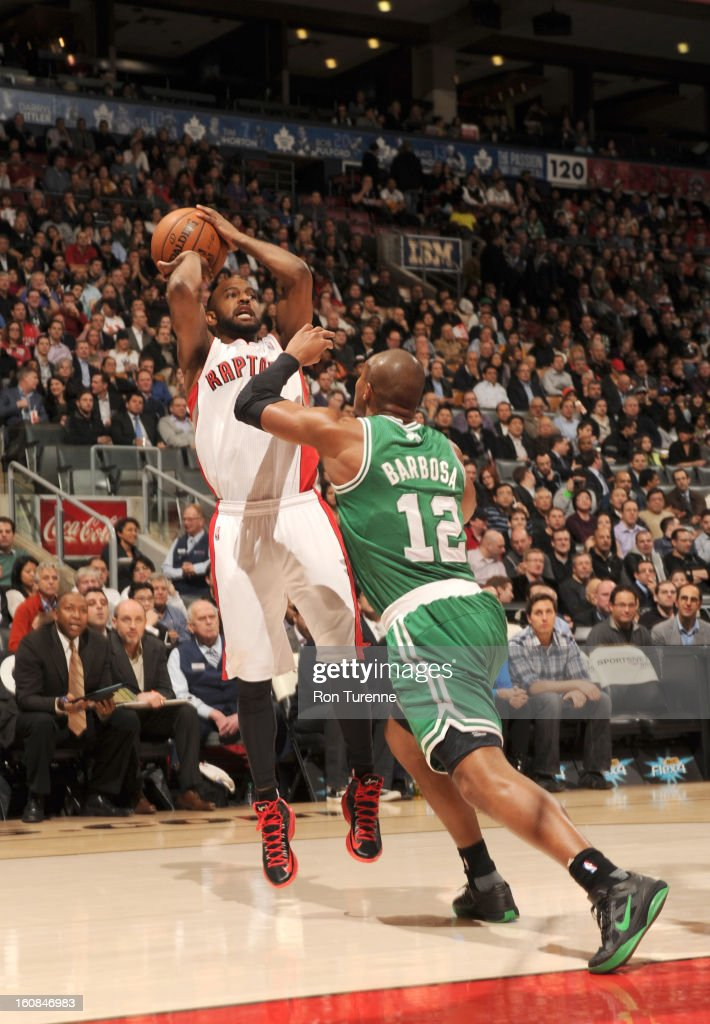 John Lucas #5 of the Toronto Raptors goes for a jump shot against Leandro Barbosa #12 of the Boston Celtics during the game between the the Toronto Raptors and the Boston Celtics on February 6, 2013 at the Air Canada Centre in Toronto, Ontario, Canada.