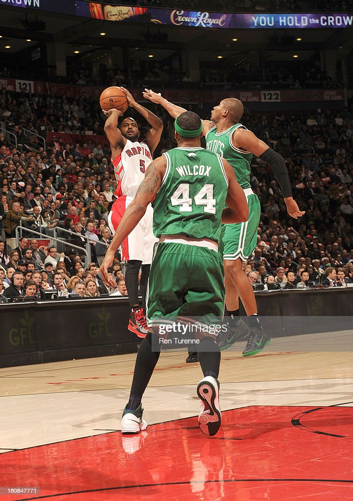 John Lucas #5 of the Toronto Raptors goes for a jump shot under pressure during the game between the the Toronto Raptors and the Boston Celtics on February 6, 2013 at the Air Canada Centre in Toronto, Ontario, Canada.