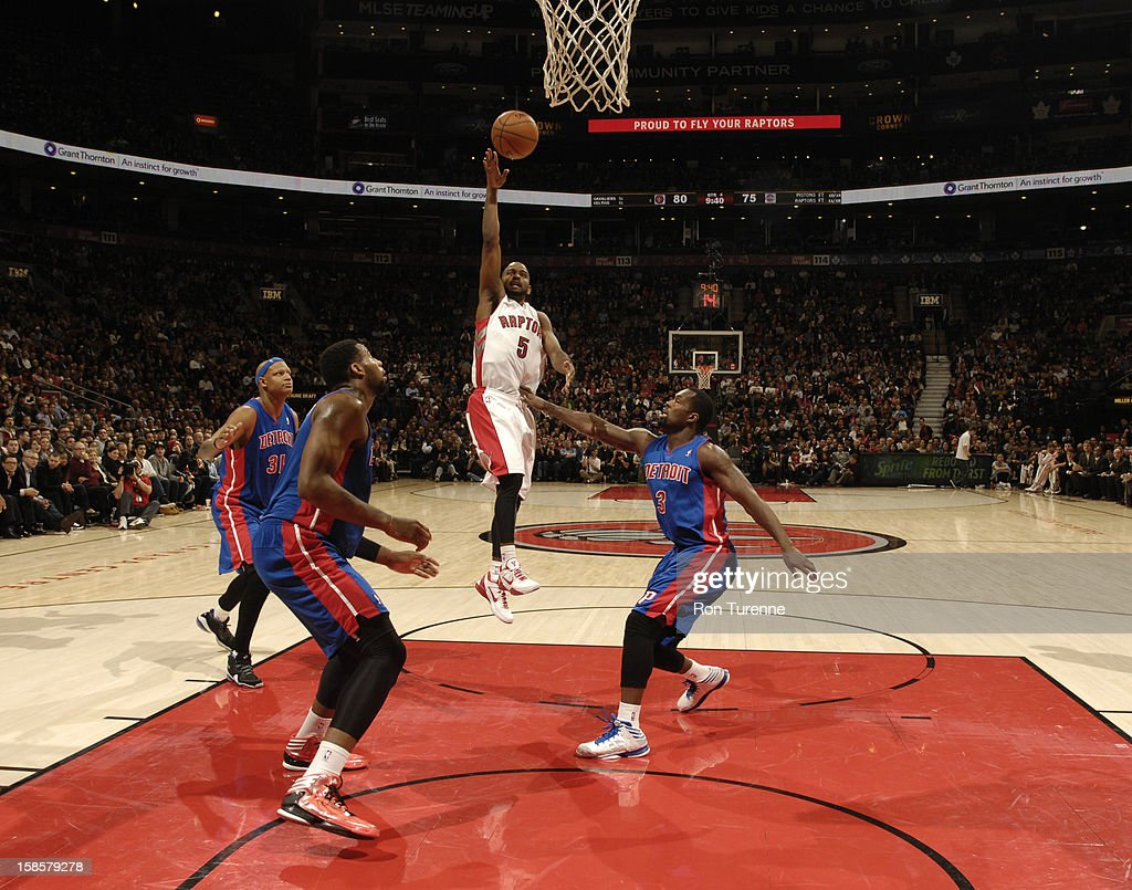 John Lucas #3 of the Toronto Raptors goes in for the simple layup against Rodney Stuckey #3 of Detroit Pistons during the game on December 19, 2012 at the Air Canada Centre in Toronto, Ontario, Canada.