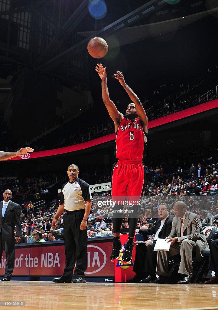 John Lucas #5 of the Toronto Raptors shoots a jumper against the Atlanta Hawks on January 30, 2013 at Philips Arena in Atlanta, Georgia.