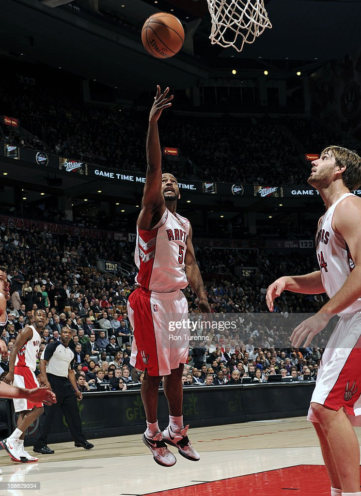 John Lucas #5 of the Toronto Raptors shoots a layup against the Brooklyn Nets on December 12, 2012 at the Air Canada Centre in Toronto, Ontario, Canada.