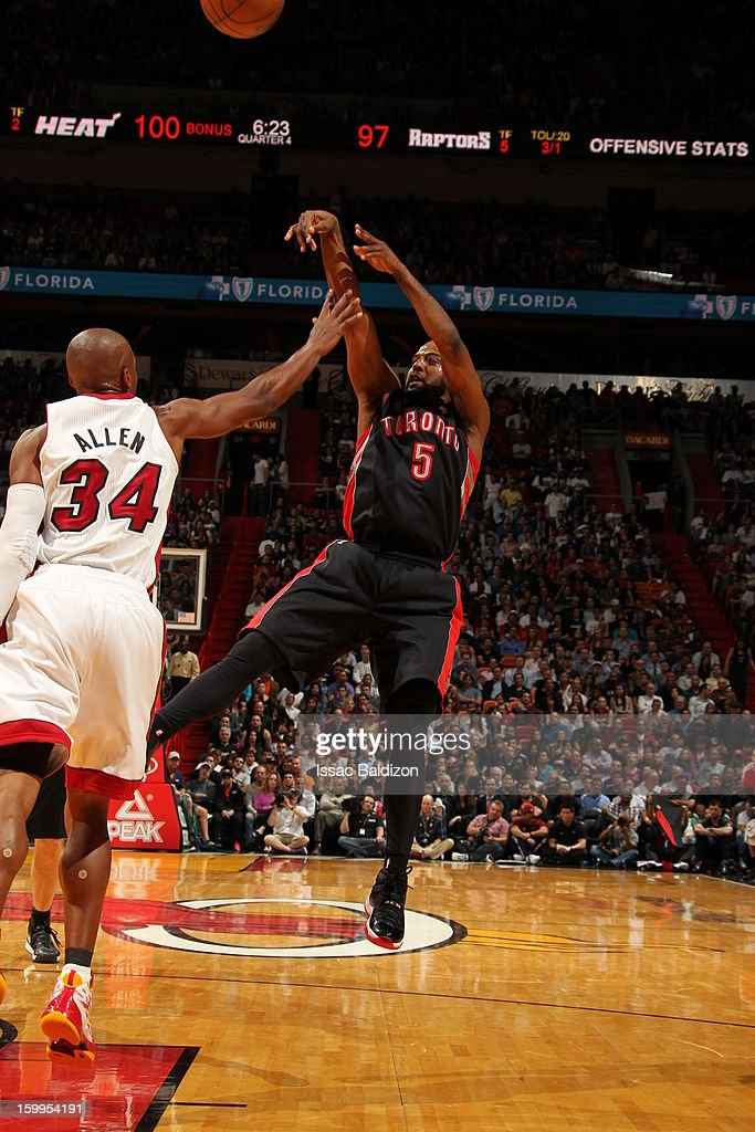 John Lucas #5 of the Toronto Raptors shoots against <a gi-track='captionPersonalityLinkClicked' href=/galleries/search?phrase=Ray+Allen&family=editorial&specificpeople=201511 ng-click='$event.stopPropagation()'>Ray Allen</a> #34 of the Miami Heat on January 23, 2013 at American Airlines Arena in Miami, Florida.