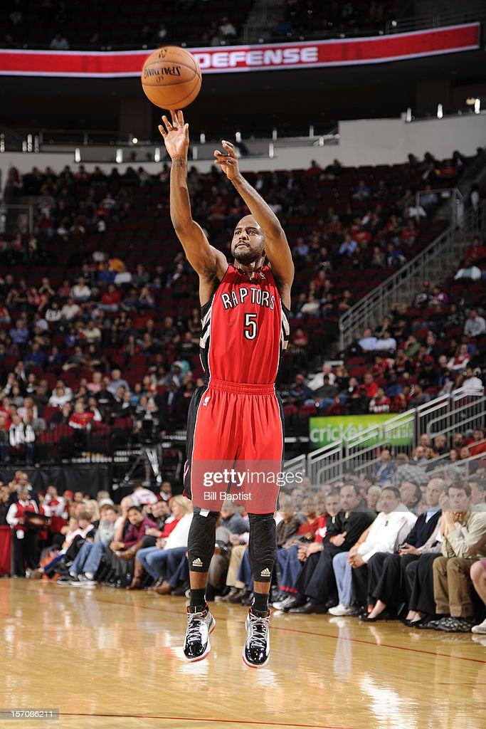 John Lucas #5 of the Toronto Raptors shoots against the Houston Rockets on November 27, 2012 at the Toyota Center in Houston, Texas.