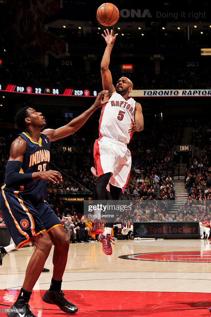 John Lucas #5 of the Toronto Raptors shoots in the lane against <a gi-track='captionPersonalityLinkClicked' href=/galleries/search?phrase=Ian+Mahinmi&family=editorial&specificpeople=740196 ng-click='$event.stopPropagation()'>Ian Mahinmi</a> #28 of the Indiana Pacers on March 1, 2013 at the Air Canada Centre in Toronto, Ontario, Canada.