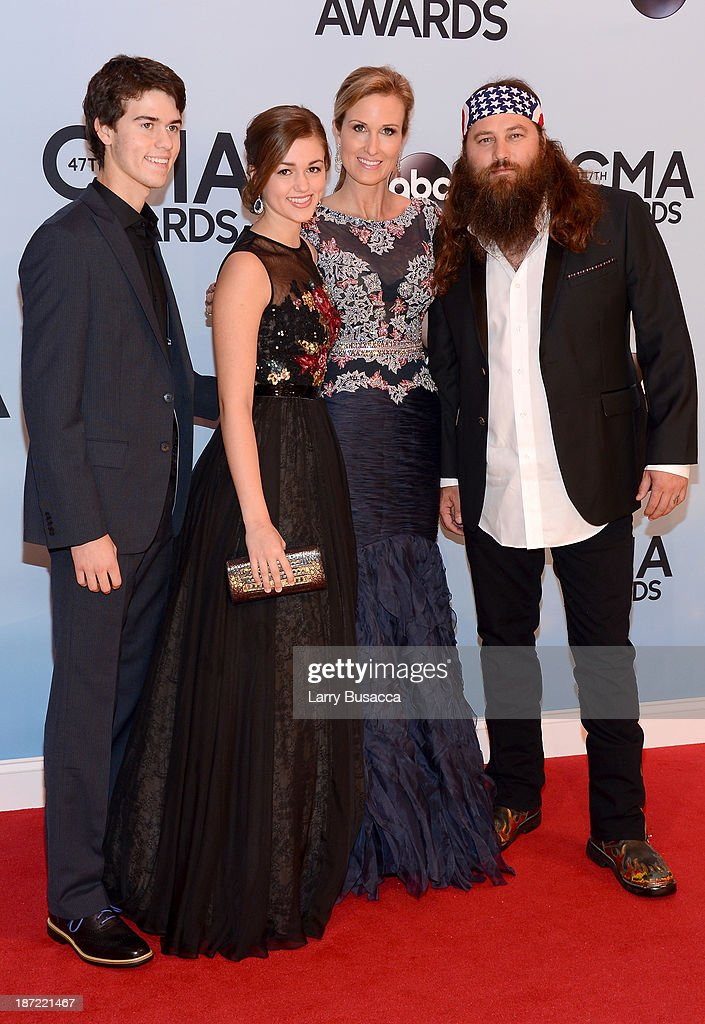 John Luke, Sadie, Korie and Willie Robertson of Duck Dynasty attend the 47th annual CMA Awards at the Bridgestone Arena on November 6, 2013 in Nashville, Tennessee.