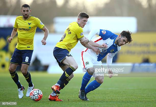 John Lundstram of Oxford United and Tony Watt of Blackburn Rovers compete for the ball during The Emirates FA Cup fourth round match between Oxford...