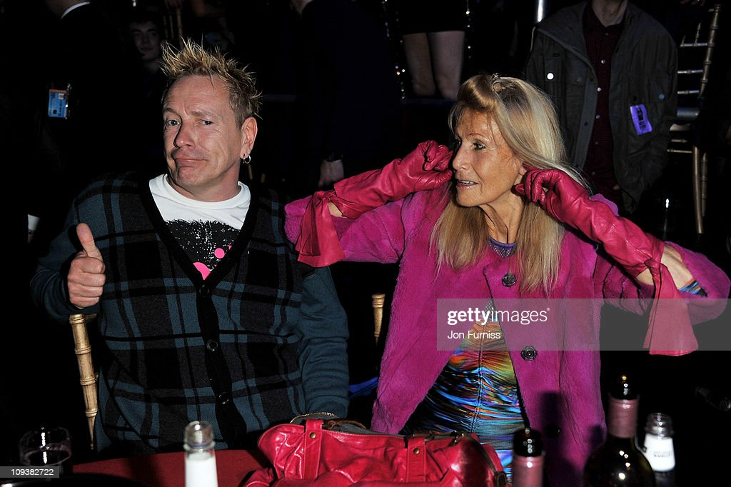 <a gi-track='captionPersonalityLinkClicked' href=/galleries/search?phrase=John+Lydon&family=editorial&specificpeople=240553 ng-click='$event.stopPropagation()'>John Lydon</a> and Nora Forster share a joke at their table at the NME Awards 2011 at Brixton Academy on February 23, 2011 in London, England.