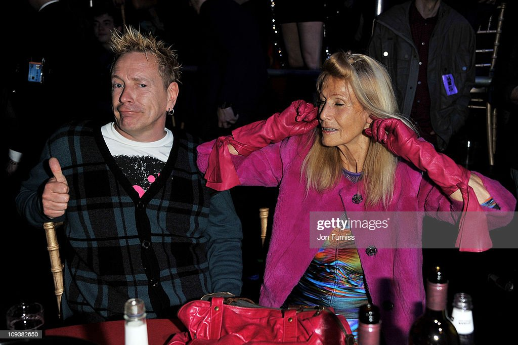 John Lydon and Nora Foster share a joke at their table at the NME Awards 2011 at Brixton Academy on February 23, 2011 in London, England.