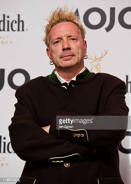 John Lydon poses in front of the winners boards after accepting the Outstanding Contribution to Music Award for PiLat the Glenfiddich Mojo Honours...