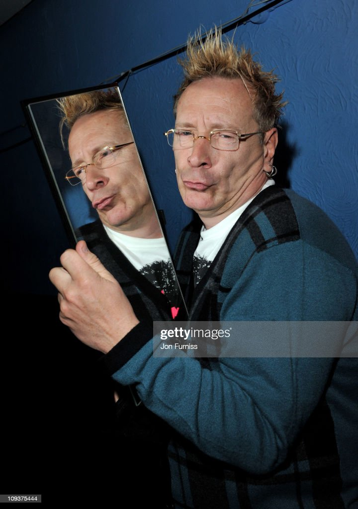 John Lydon poses with the award fo r'Best Book' during the NME Awards 2011 at Brixton Academy on February 23, 2011 in London, England.