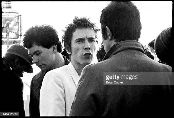 John Lydon singer with English punk rock band the Sex Pistols with film maker Julien Temple behind him aboard the Queen Elizabeth on the River Thames...