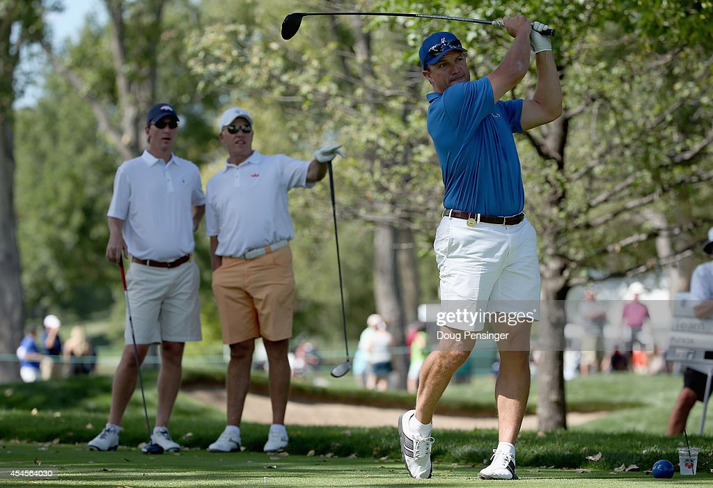 John Lynch (R) hits his tee shot on the second hole as teammates Cooper Manning (L) and <a gi-track='captionPersonalityLinkClicked' href=/galleries/search?phrase=John+Elway&family=editorial&specificpeople=204173 ng-click='$event.stopPropagation()'>John Elway</a> (C) look on during the Gardner Heidrick Pro-Am ahead of the BMW Championship at the Cherry Hills Country Club on September 3, 2014 in Cherry Hills Village, Colorado. The trio was teamed with Russell Knox of Scotland.
