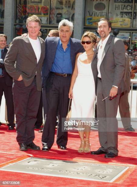 John Madden Jay Leno Lisa Marie Presley and Nicolas Cage at the Hand and Footprint ceremony honoring Cage at Grauman's Chinese Theater in Hollywood
