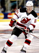 John Madden of the New Jersey Devils skates against the New York Islanders during the preseason game at the Arena at Harbor Yard on September 29 2007...