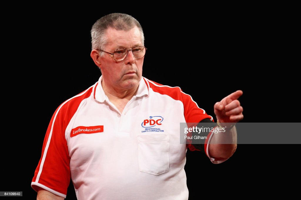 John MaGowan celebrates winning a leg in the first round match between Chris Mason of England and John MaGowan of Northern Ireland during the 2009...