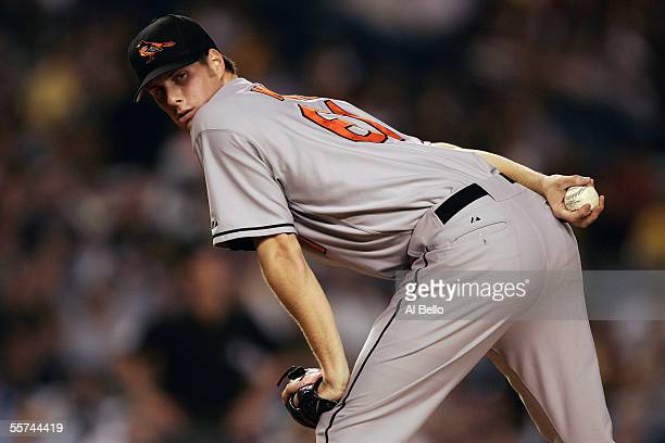 John Maine of the Baltimore Orioles keeps an eye on first base during a game against of the New York Yankees at Yankee Stadium on September 20 2005...