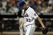 John Maine of the New York Mets walks off the mound after the fourth inning against the Florida Marlins on April 7 2010 at Citi Field in the Flushing...