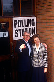 John Major poses outside his constituency polling station with wife Norma seeking reelection after replacing Margaret Thatcher Major won this...