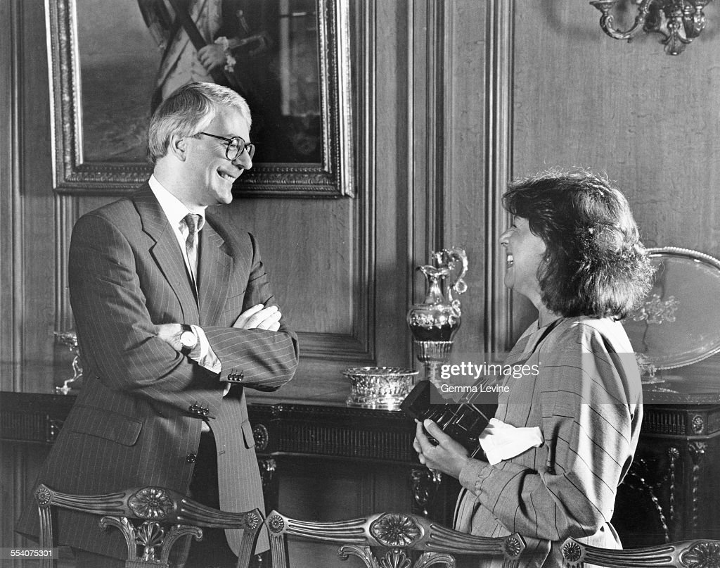 John Major Prime Minister of the United Kingdom chatting with photographer Gemma Levine at 10 Downing Street in London after a photo session for the...